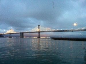 Dusk view of bay bridge lights from sinbads